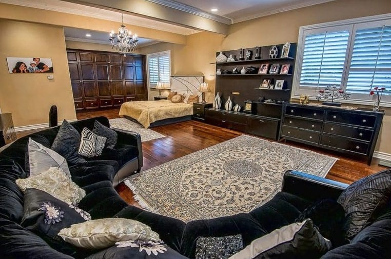 Another shot of the master bedroom focusing on the comfortable seating space and stylish rug.