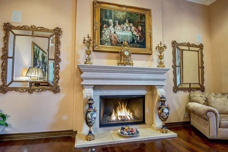 A focused shot at the living room's elegant room decorations and fireplace.