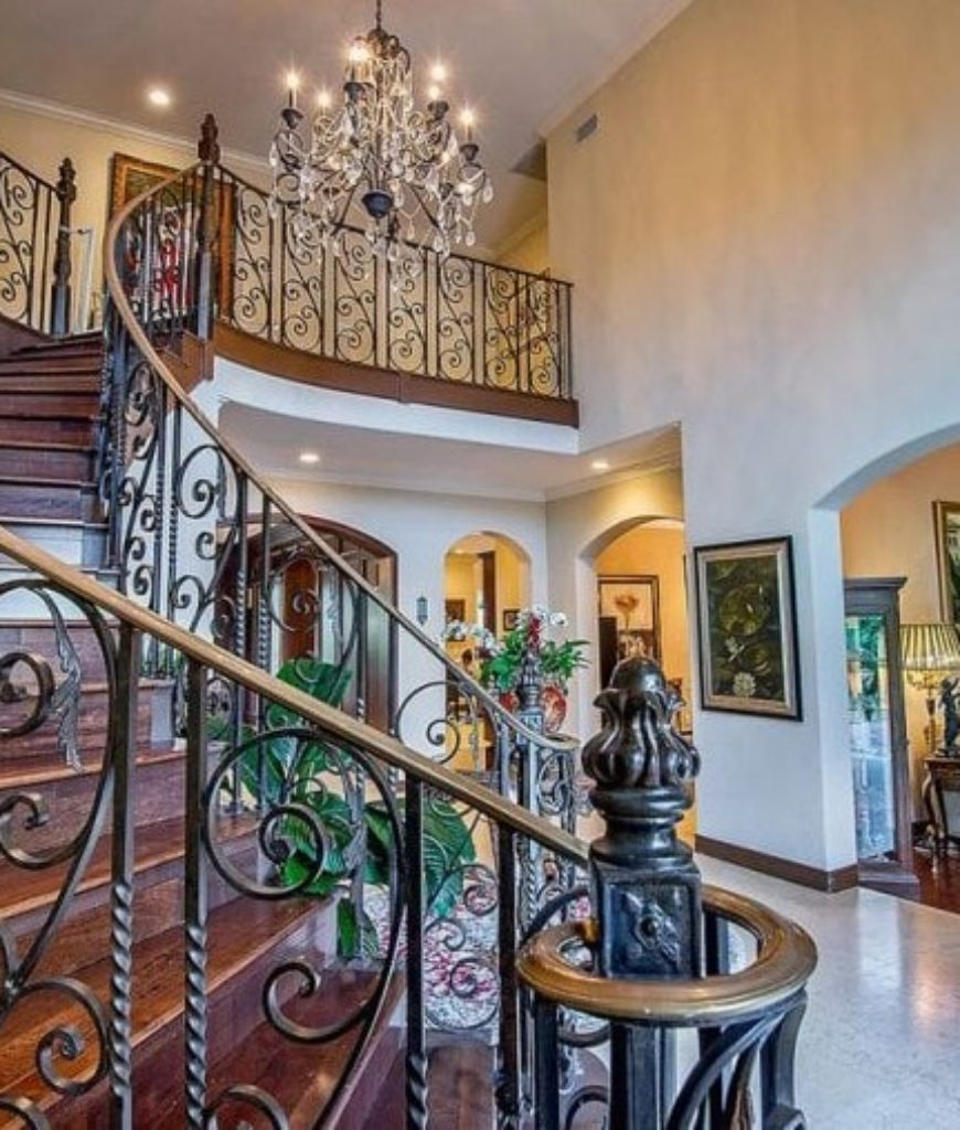 The grand foyer welcomes guests and family upon entering the mansion.