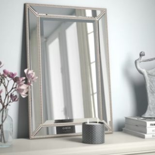 A bevelled wall mirror.