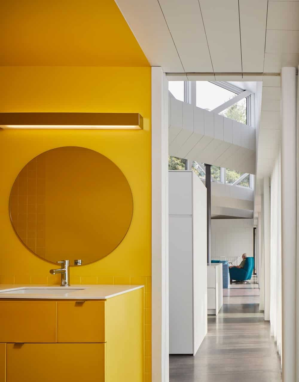 Hallway with white walls together with yellow walled single sink. Photographer: Doublespace Photography / Designers: Julia Jamrozik and Coryn Kempster / Structural Engineer: Jim Thomson / General Contractor: Timberline Custom Homes / Landscape Design: Gray Landscape Construction