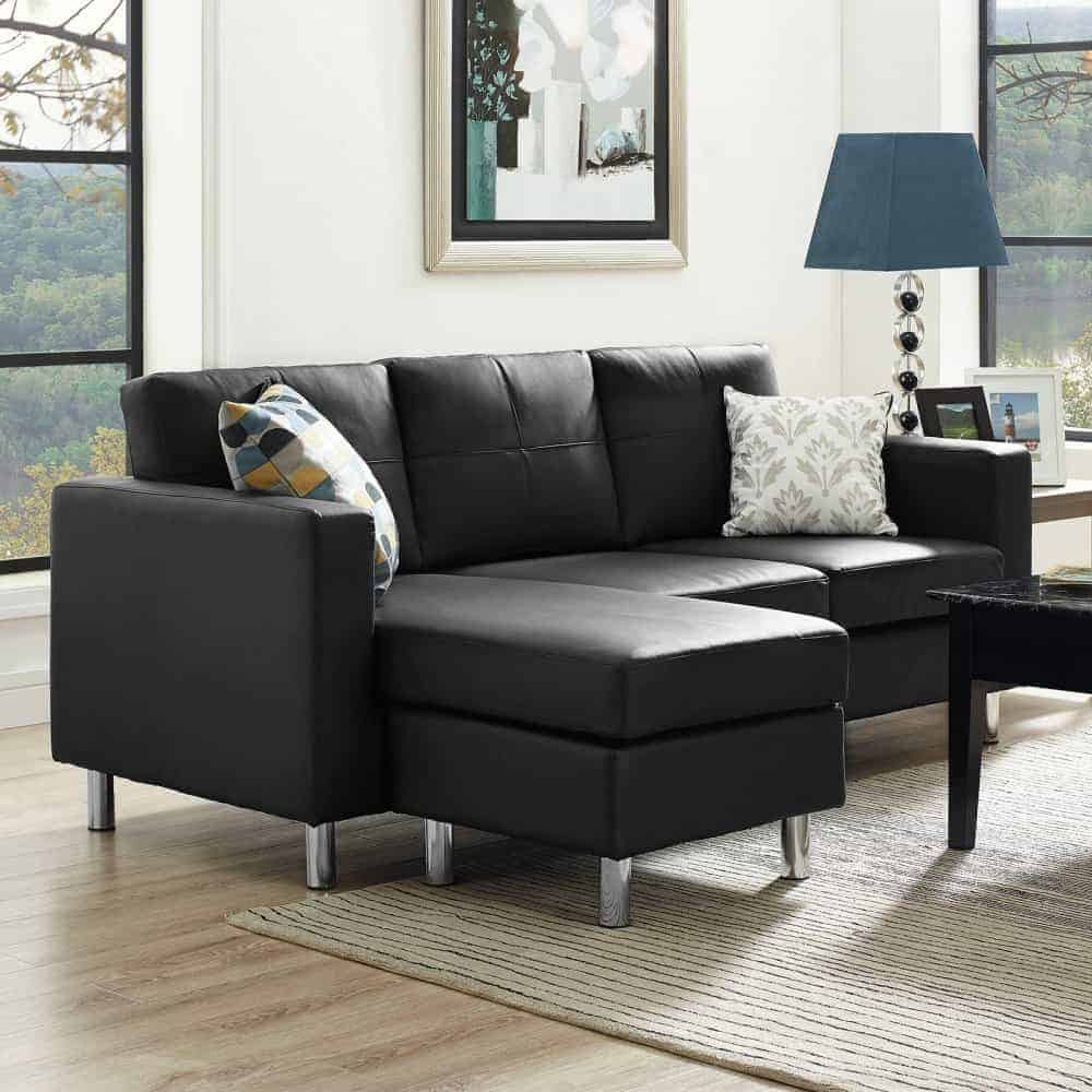 Small spaces configurable sectional sofa with durable frame construction and black faux leather upholstery.
