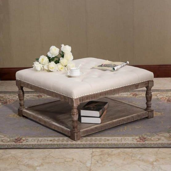 A tufted ottoman that functions as a coffee table.