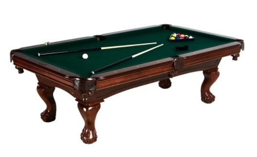 Standard pool table with its surface made out of green wool.