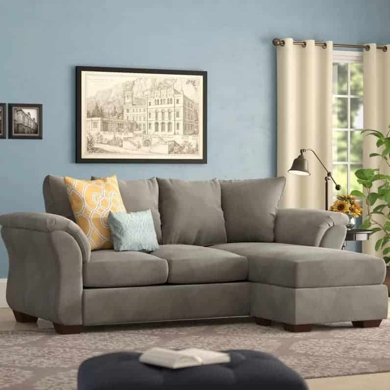 Espresso sectional sofa with pillow top arms and pillow back.