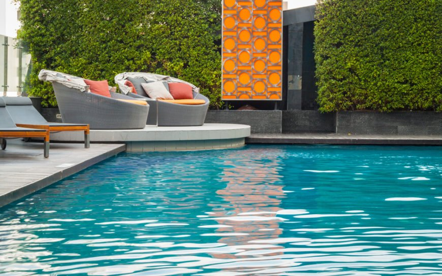 Pool at home with two single-seat sofas.