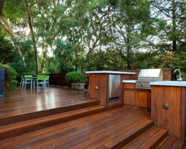 A spacious deck features a barbecue area and a patio perfect for bonding with family or friends.