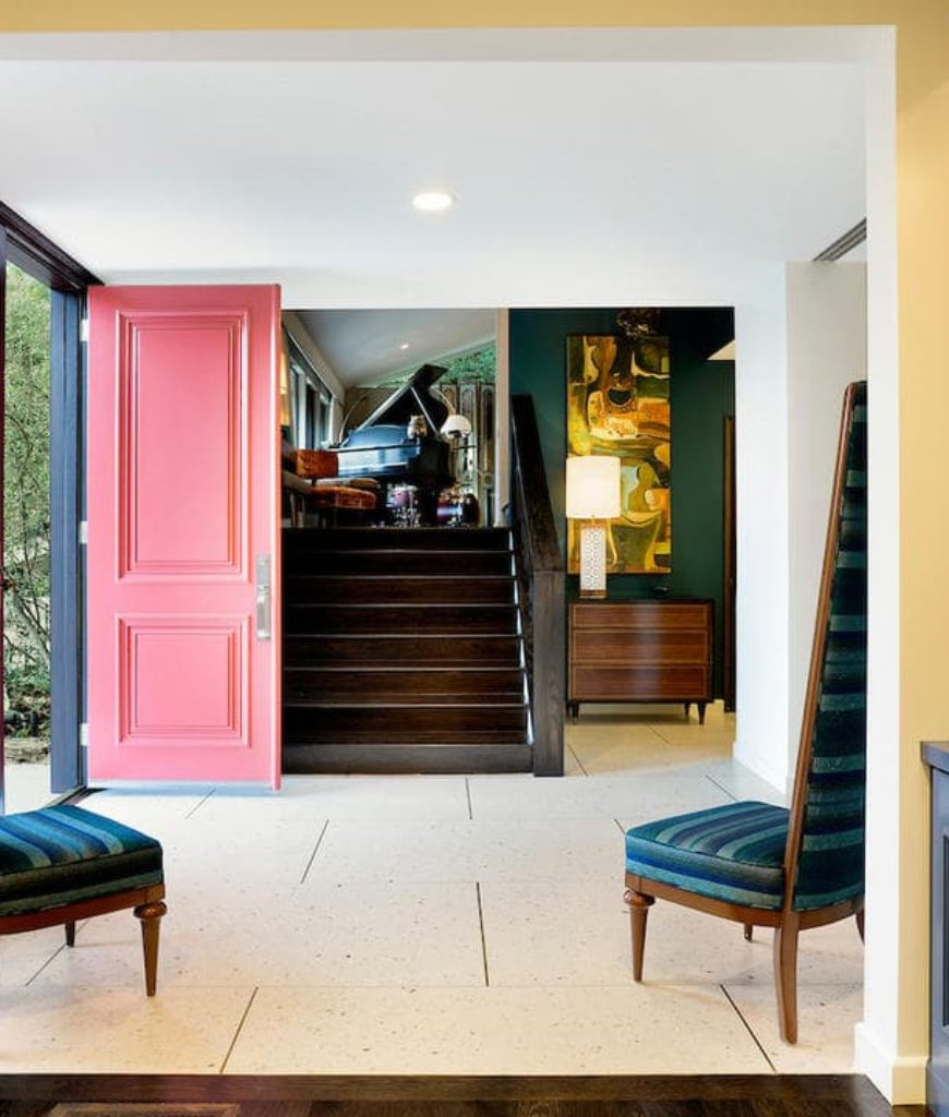 Family and friends are welcomed by the colorful foyer leading to the house's living room.
