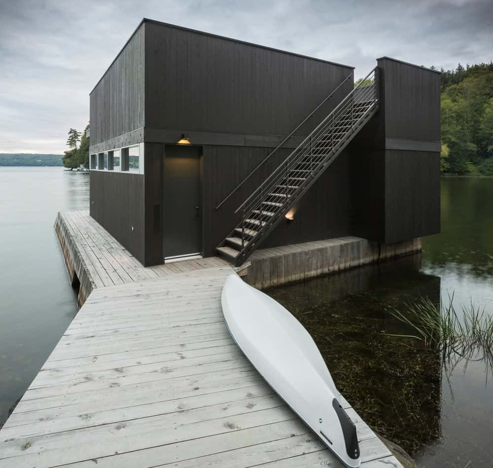 This modern house features set on the middle of the lake.