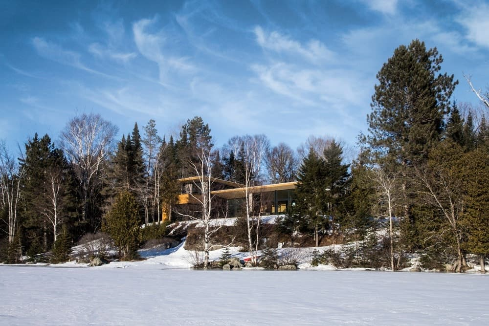 The outside view of the house shows the beauty of the landscape surrounding it. Photo Credit: David Marien-Landry