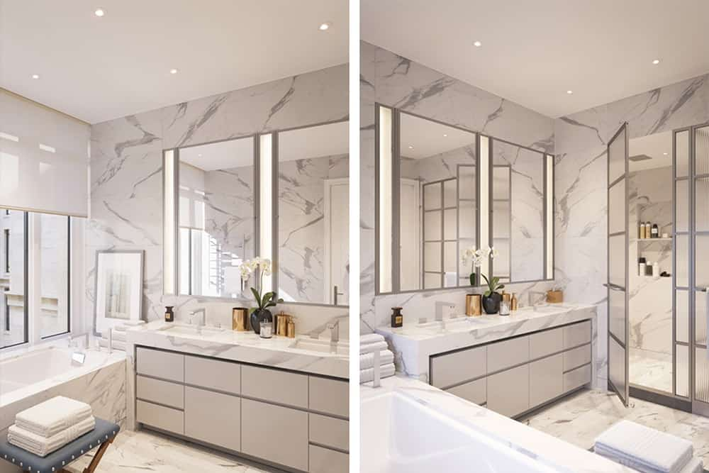 The luxurious bathroom boast marble countertops, walls, floors and tub.