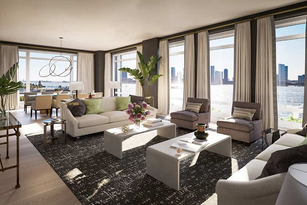 This living room offers cozy couches set on a very stylish rug.