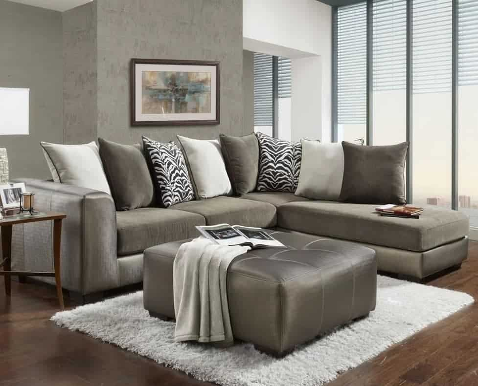 Kinneret arms stationary sectional sofa with foam seat fill and pillow back.