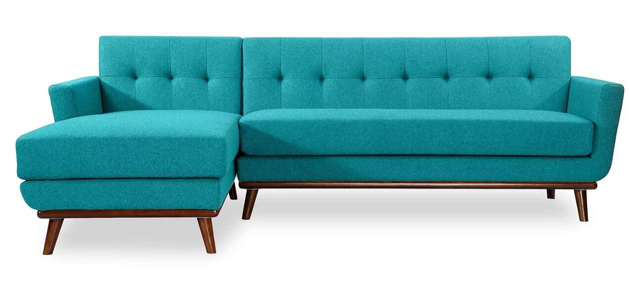 Large stationary sectional sofa with twill upholstery and foam seat.