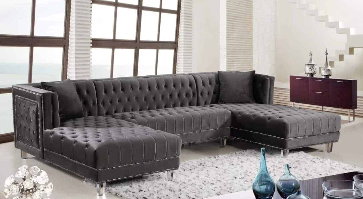 High end velvet upholstery sectional sofa with double chaise and removable legs.