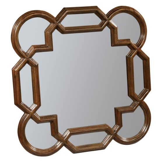 A quatrefoil mirror with carved wood frame.
