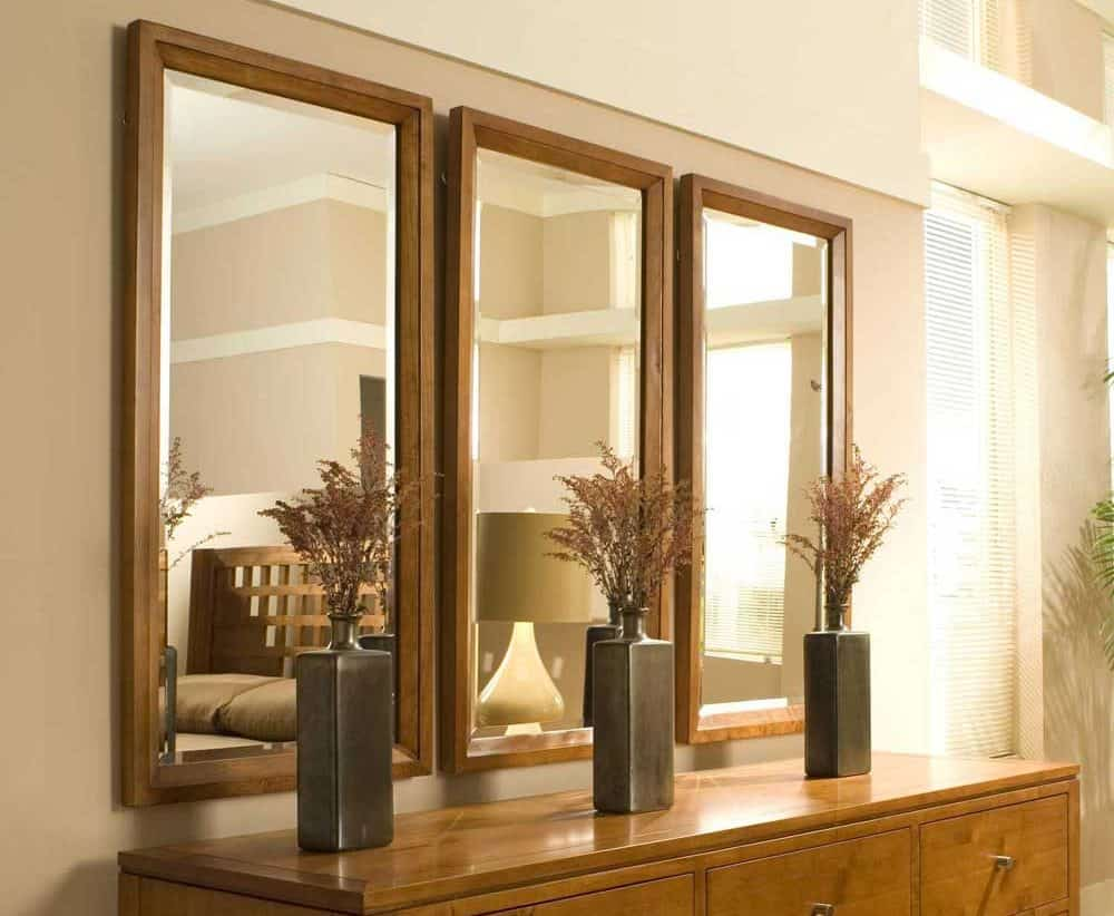 A trio of large rectangular mirrors by the console.