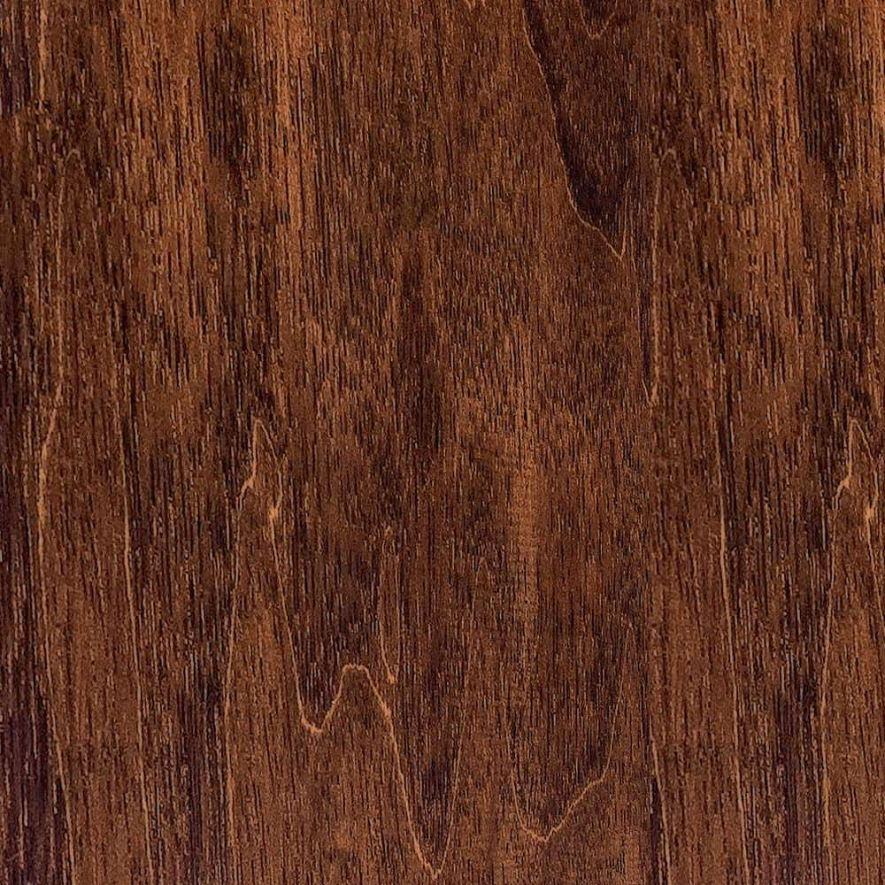 Solid walnut flooring with a hand-scraped texture.