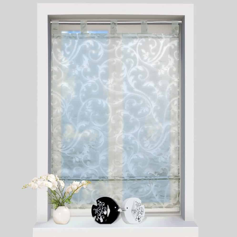 Sheer shutter with detailed designs.