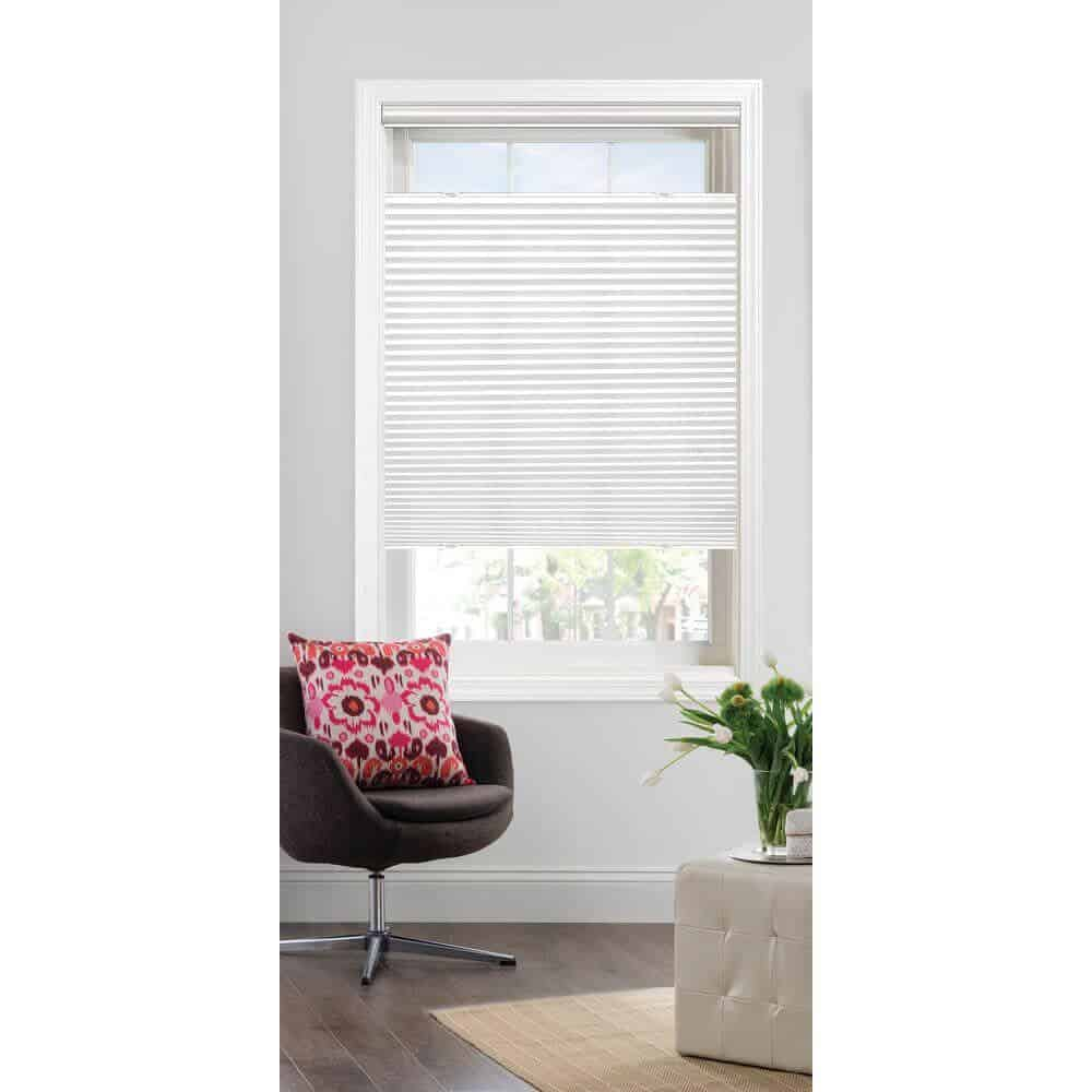 White, cellular shades with a single cell.