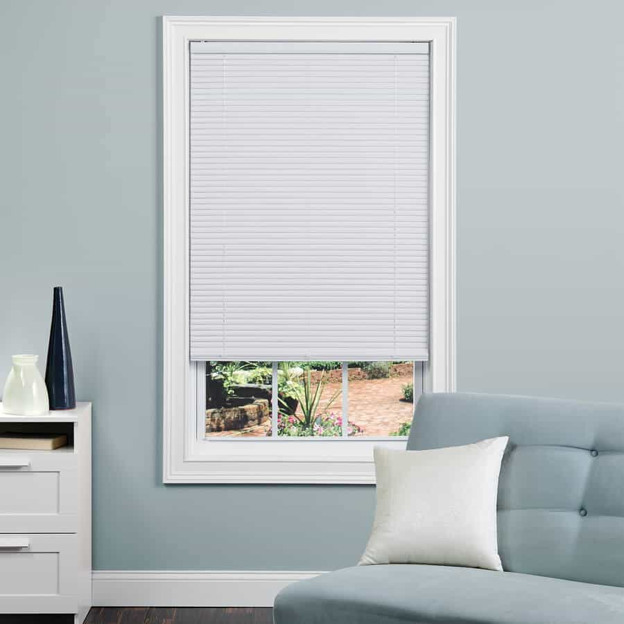 White vinyl blinds with a minimalistic aesthetic.