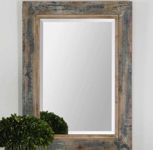 A mirror with vintage frame.