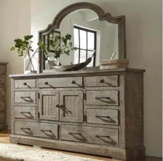 A dresser with a mirror.