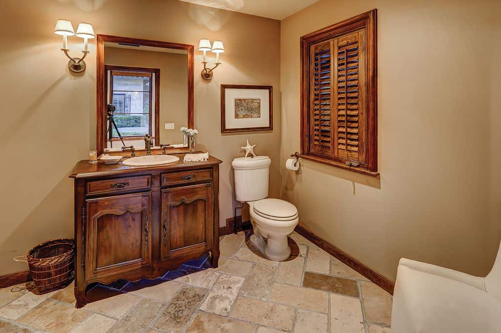 Nice tuscan style powder room with wood vanity.