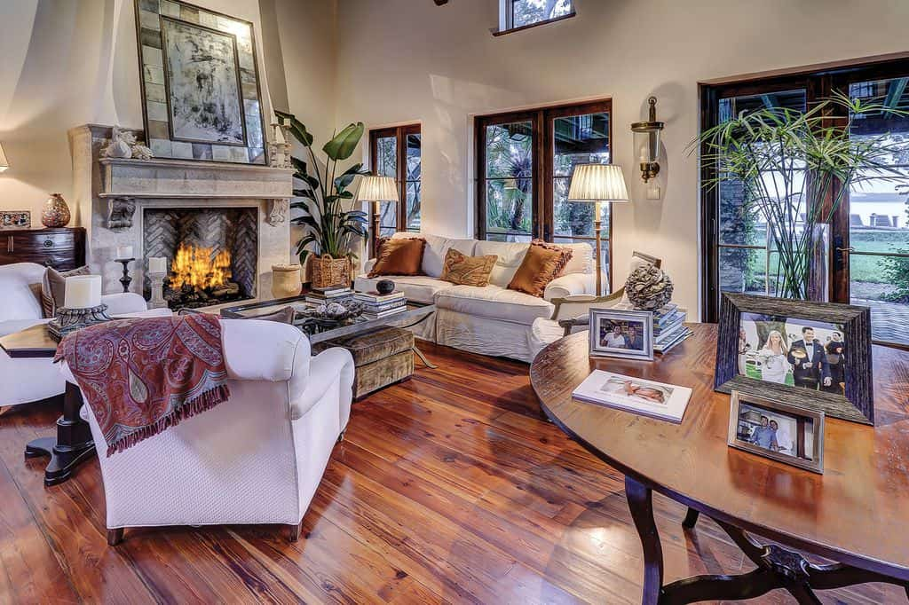 The hardwood flooring of this formal living room looks very attractive. The fireplace is very stylish as well.