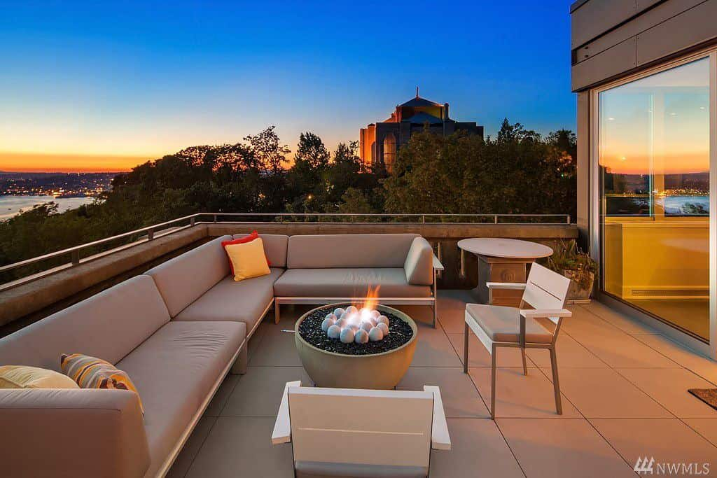Patio with gas fire pit, view and large sectional sofa.