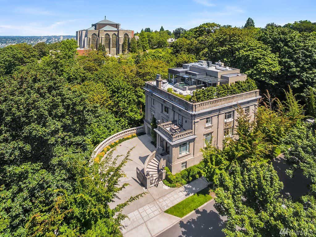 Aerial view of old-world mansion on a hill.