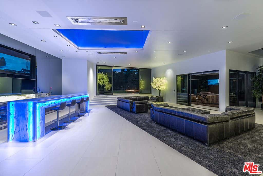 Modern family room with bar.