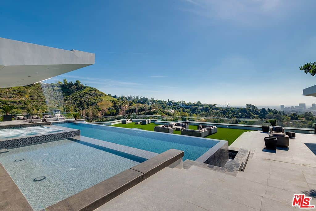 Backyard with stunning view and pool.