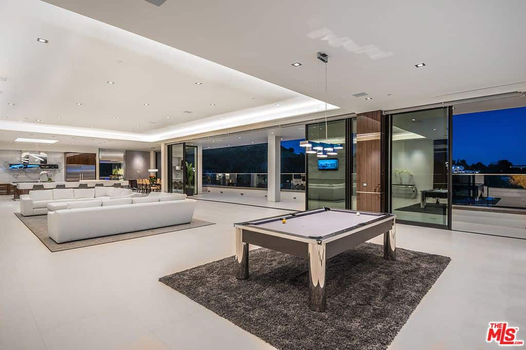 Large game room with pool table.