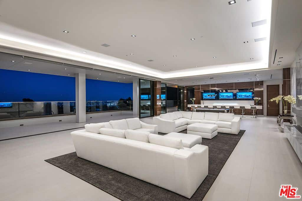 Large formal living room with white sofas.