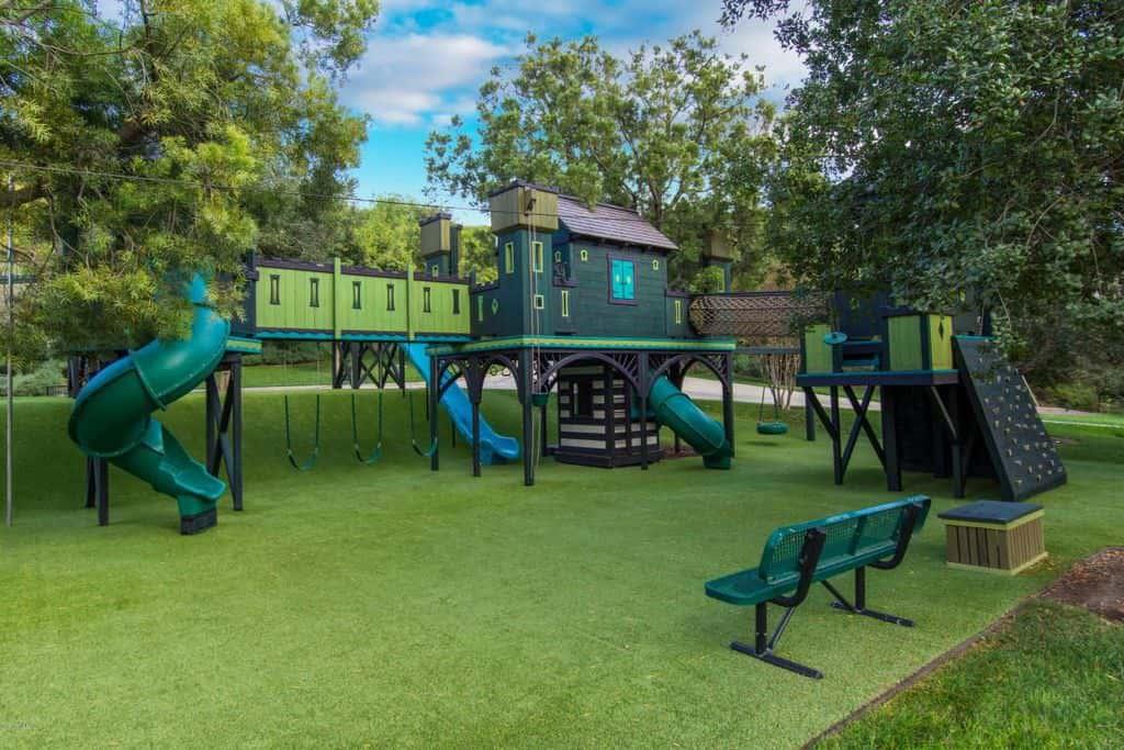 Incredible backyard playground and playhouse for kids with tube slide.