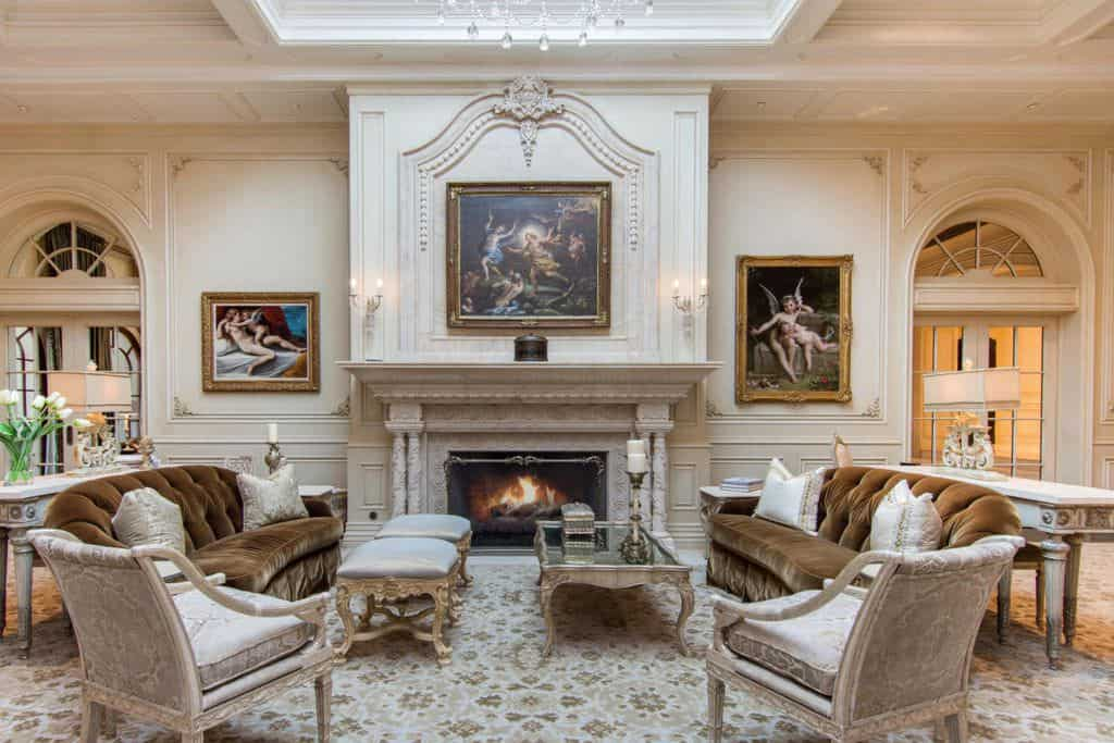 The paintings on the walls of this formal living room are very attractive. The large fireplace is an eye-catching piece as well. The flooring is absolutely classy.