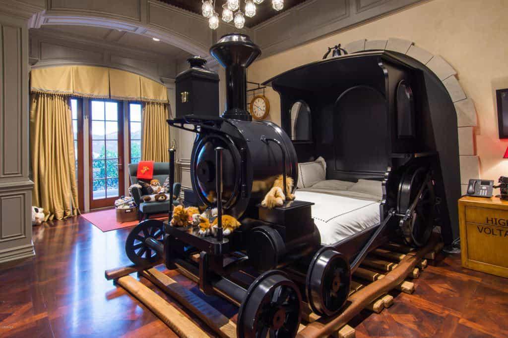 Kids bedroom with custom train bed