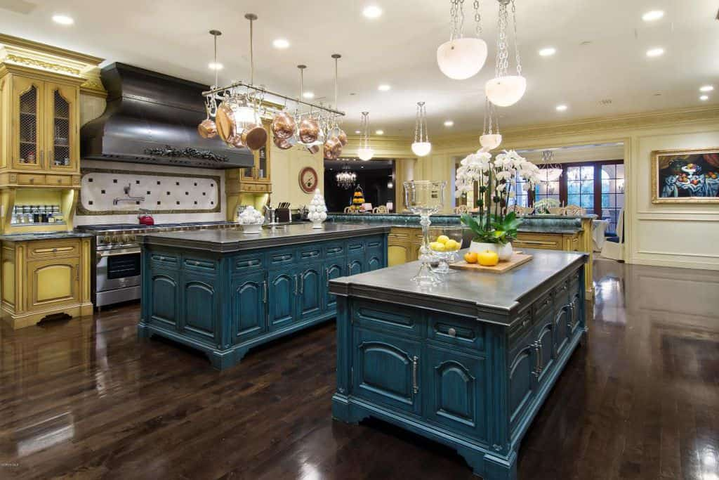 Massive custom kitchen with two islands.