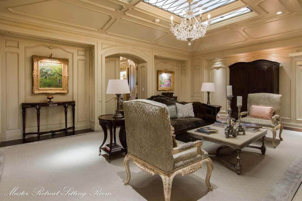 An elegant living room set with luxurious seats, walls, ceiling, flooring and even lighting.