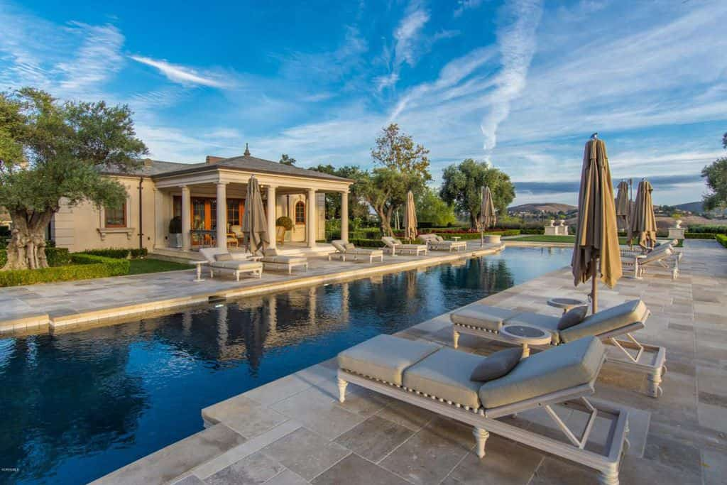 Huge swimming pool with pool house