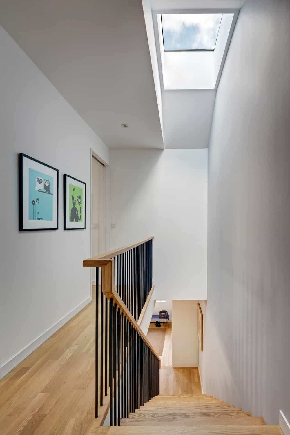 Straight staircase with vinyl flooring and white walls. Photo Credit: Francis Dzikowski/OTTO