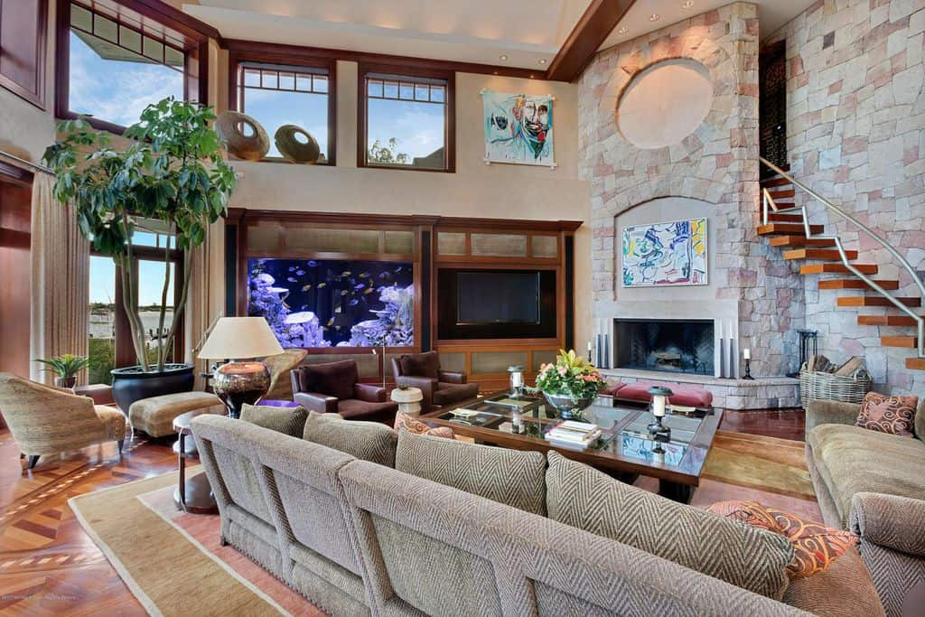 Large two story family room with fireplace and comfortable sofas.