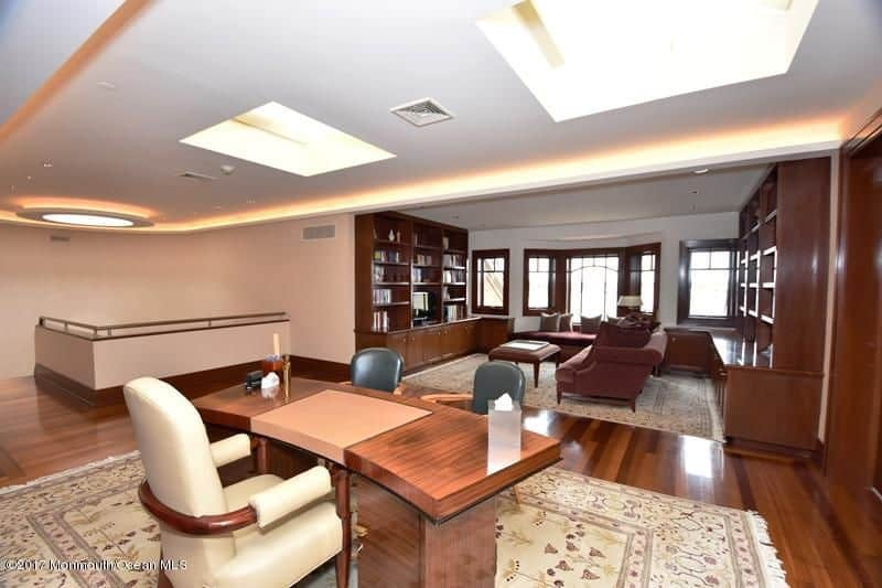 Home office with large sitting area and skylights