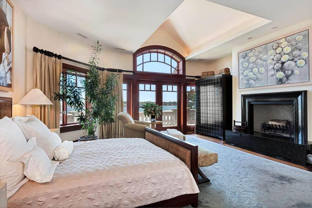 Spacious primary bedroom with plenty of custom woodwork.