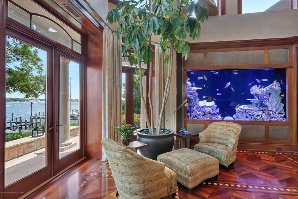 Reading nook next to large aquarium