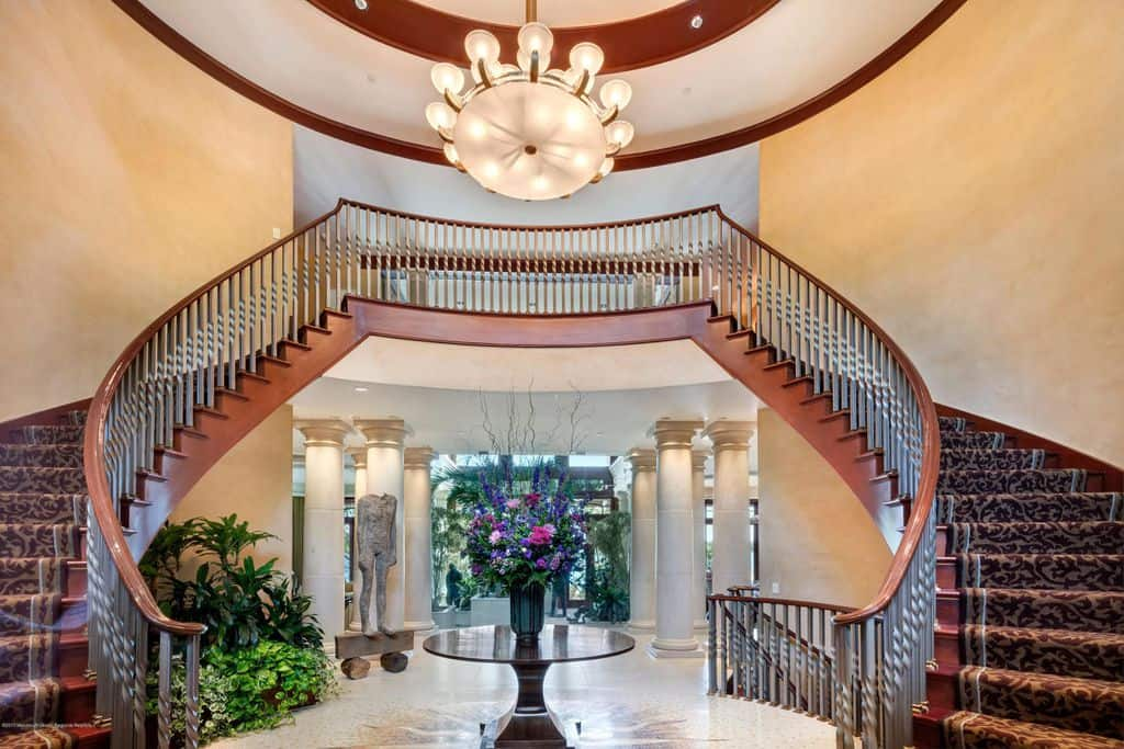 Grand bifurcated staircase with upper landing and chandelier