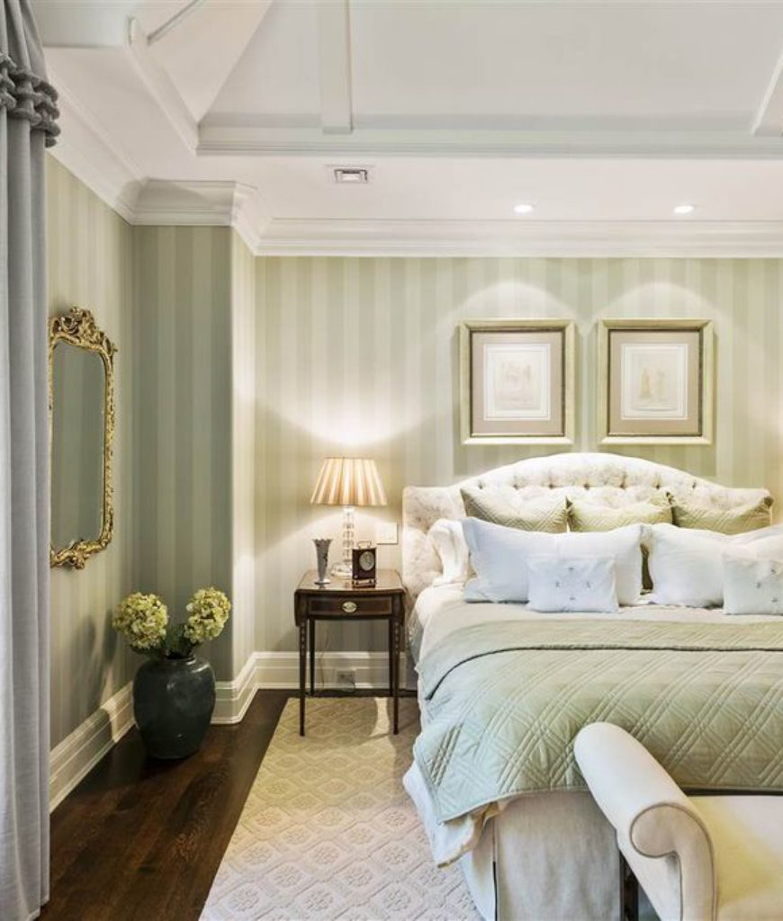 Master bedroom in green and white.