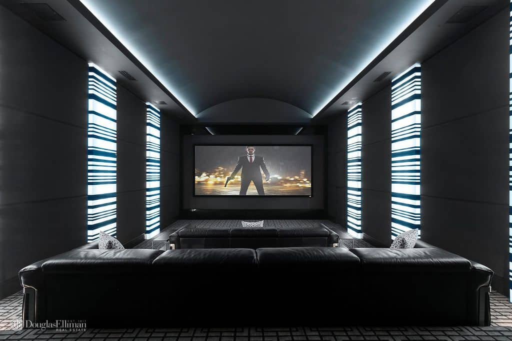 Beau The Home Also Has A Home Theater Featuring A Bar And A Hardwood Flooring  Perfect For Entertaining Guests And Hosting A Movie Marathon With Friends.