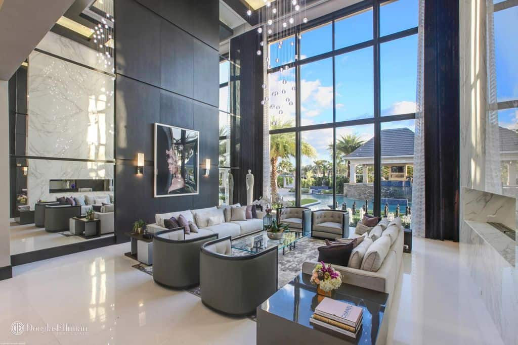 Huge two-story luxury living room with massive picture window.